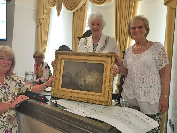 Mayor of Fylde Angela Jacques receives the 'Three Sheep's Heads' Richard Ansdell sketch from Sarah Kellam & Chair of the Friends Margaret Race