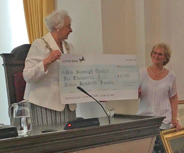 Mayor of Fylde Angela Jacques receives the cheque from Chair of the Friends Margaret Race for the Hebe & Amphitrite conservation